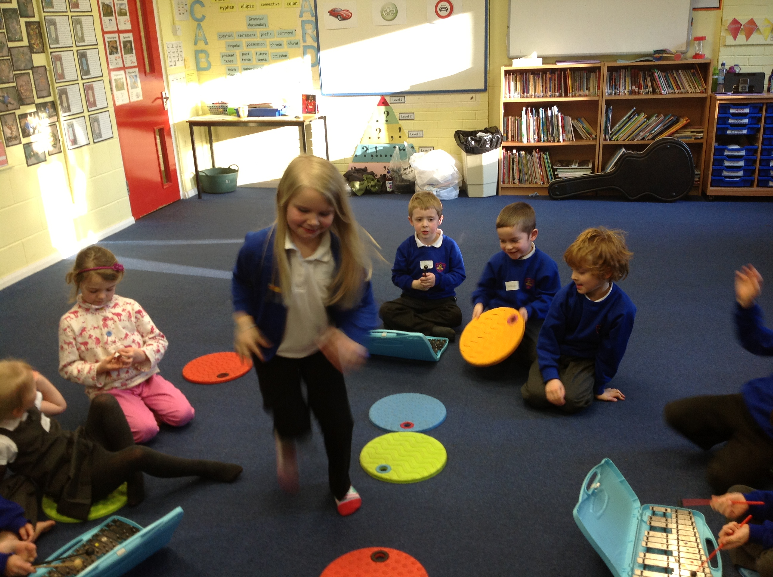 Primary infants hopping on coloured spots
